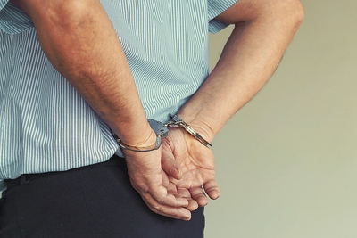 Elderly Man in Handcuffs
